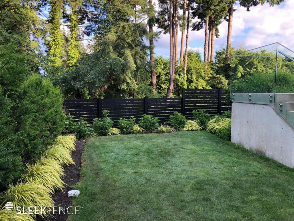 New landscape with black horizontal slat fence
